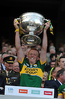 Johnny Buckley lifts the Sam Maguire Cup to celebrate  Kerry's victory over Donegal in the All-Ireland Football Final against  in Croke Park 2014.<br /> Photo: Don MacMonagle<br /> <br /> <br /> Photo: Don MacMonagle <br /> e: info@macmonagle.com