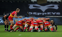 Sarel Pretorius of the Dragons (L) drops the ball into a scrum during the Guinness PRO14 match between Ospreys and Dragons at The Liberty Stadium, Swansea, Wales, UK. Friday 27 October 2017