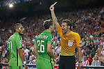 Referee shows a yellow card to Juventus´s Lichtsteiner during Champions League soccer match between Atletico de Madrid and Juventus at Vicente Calderon stadium in Madrid, Spain. October 01, 2014. (ALTERPHOTOS/Victor Blanco)