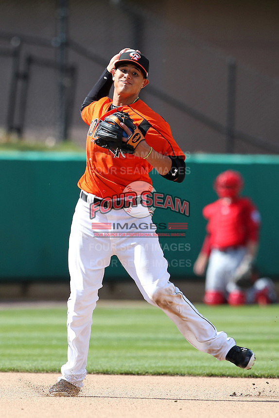 Bowie BaySox shortstop Manny Machado #3 throws to first during a game against the Harrisburg Senators at Prince George's Stadium on April 8, 2012 in Bowie, Maryland.  Harrisburg defeated Bowie 5-2.  (Mike Janes/Four Seam Images)