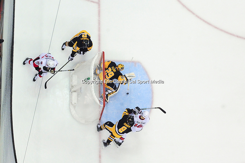 May 15, 2017: Pittsburgh Penguins goalie Marc-Andre Fleury (29) makes a save during game two of the National Hockey League Eastern Conference Finals between the Ottawa Senators and the Pittsburgh Penguins, held at PPG Paints Arena, in Pittsburgh, PA. Pittsburgh defeats Ottawa 1-0 in regulation to tie the series 1-1. Eric Canha/CSM