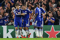 Cesar Azpilicueta of Chelsea (2nd left) celebrates the opening goal with team mates after an own goal puts Chelsea 1-0 ahead during the UEFA Champions League Group match between Chelsea and Dynamo Kyiv at Stamford Bridge, London, England on 4 November 2015. Photo by David Horn.
