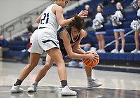 Heritage Maddie Lynge (3) looks for an opening past Har-Ber guard Kania Starks (21), Friday, February 7, 2020 during a basketball game at Wildcat Arena at Har-Ber High School in Springdale. Check out nwaonline.com/prepbball/ for today's photo gallery.<br /> (NWA Democrat-Gazette/Charlie Kaijo)