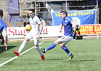 Graham Webster clears before being tackled by Josh Todd in the SPFL Ladbrokes Championship Play Off semi final match between Queen of the South and Montrose at Palmerston Park, Dumfries on 11.5.19.