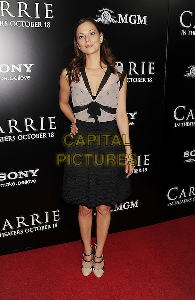 Tamara Braun<br /> &quot;Carrie&quot; Los Angeles Premiere held at Arclight Cinemas, Hollywood, California, USA.<br /> October 7th, 2013<br /> full length black skirt top pink dress hand on hip<br /> CAP/ROT/TM<br /> &copy;Tony Michaels/Roth Stock/Capital Pictures