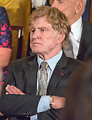 Actor, director, producer, businessman, and environmentalist Robert Redford looks on as United States President Barack Obama makes remarks at a ceremony in the East Room of the White House in Washington, DC where he is to present the Presidential Medal of Freedom, the Nation's highest civilian honor, on Tuesday, November 22, 2016.<br /> Credit: Ron Sachs / CNP