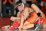 SIOUX FALLS, SD - DECEMBER 28:  Kyle Yasgar from Roosevelt has control of Luke Loudenburg from Howard in their 138 pound championship match Saturday afternoon December 28, 2013 at Lincoln High School in Sioux Falls, South Dakota. (Photo by  Dave Eggen/Inertia)
