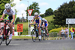Passing by The Covert Bar during the Irish National Men's Elite Road Race Championships held over an undulating course featuring 9 laps centered around the village of Multyfarnham, Co.Westmeath, Ireland. 29th June 2014.<br /> Picture: Eoin Clarke www.newsfile.ie