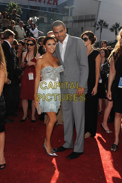 EVA LONGORIA PARKER & TONY PARKER .The 60th Annual Primetime Emmy Awards held at The Nokia Theatre in Los Angeles, California, USA, .September 21st 2008.     .emmys red carpet arrivals Full length white grey gray silver fringed tassels dress clutch bag pointy shoes heels bob bow suit married husband wife pointy shoes heels .CAP/DVS.©Debbie VanStory/Capital Pictures