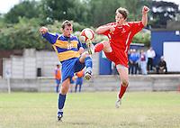 Kevin Neville of Romford (L) tangles with Danny Slatter of Aveley - Romford vs Aveley - Pre-Season Friendly Match at Mill Field, Aveley FC - 31/07/10 - MANDATORY CREDIT: Gavin Ellis/TGSPHOTO - Self billing applies where appropriate - Tel: 0845 094 6026