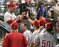Phillies IF Eric Bruntlett is greeted after he scores on Thursday May 22nd at Minute Maid Park in Houston, Texas. Photo by Andrew Woolley / Four Seam Images.