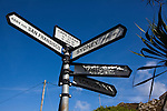 Sign giving distances - in nautical miles - to places around the world, on Cape Clear Island, Ireland's most southerly inhabited island, off the coast of Co. Cork