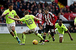 Aaron Phillips of Northampton Town challenges Kieron Freeman of Sheffield United during the English Football League One match at Bramall Lane, Sheffield. Picture date: December 31st, 2016. Pic Jamie Tyerman/Sportimage