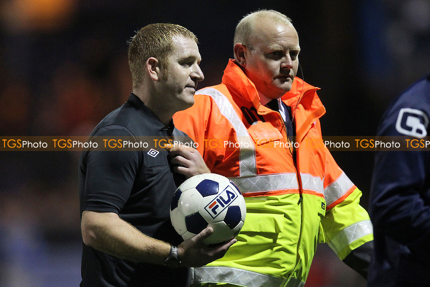 Referee Swabey is escorted from the field at half-time - Luton Town vs Braintree Town - Blue Square Conference Football at Kenilworth Road, Luton - 09/10/12 - MANDATORY CREDIT: Gavin Ellis/TGSPHOTO - Self billing applies where appropriate - 0845 094 6026 - contact@tgsphoto.co.uk - NO UNPAID USE.