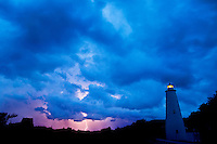 Lightening flashes from a blanket of storm clouds that filled the summer sky at dusk over the popular Ocracoke Lighthouse. Ocracoke Light remains among the oldest lighthouses still active on the southern coast of North Carolina's Outer Banks, and it is the second oldest operating lighthouse in the United States (the first is Sandy Hook Light house in New Jersey). The first Ocracoke Lighthouse was built in 1803 on Shell Castle Island inside the Ocracoke Inlet not far from Blackbeard's hideout. Destroyed by lightning in 1818 it was replaced by the current light in 1823 on the banks of the inlet near Ocracoke Village. The white-brick conical lighthouse stands 75 feet tall and has 220 stairs to its top, though visitors are not allowed to climb. Ocracoke Island can only be reached by ferry. Charlotte NC photographer Patrick Schneider has extensive photo collections of the following lighthouses: Bodie Island Lighthouse, Bald Head Island Lighthouse, Cape Fear Lighthouse, Cape Hatteras Lighthouse, Cape Lookout Lighthouse, Currituck Beach Lighthouse, Diamond Shoal Lighthouse, Federal Point Lighthouse, Oak Island Lighthouse, and Ocracoke Lighthouse on Ocracoke Island.