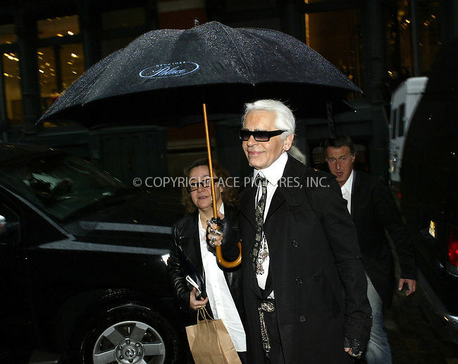 WWW.ACEPIXS.COM . . . . .  ....NEW YORK, MARCH 28, 2005....On a rainy New York Monday, Karl Lagerfeld heads out to lunch an umbrella assistant in tow.....Please byline: IAN WINGFIELD - ACE PICTURES.... *** ***..Ace Pictures, Inc:  ..Craig Ashby (212) 243-8787..e-mail: picturedesk@acepixs.com..web: http://www.acepixs.com