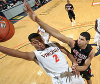 Dec. 22, 2010; Charlottesville, VA, USA; Virginia Cavaliers guard Mustapha Farrakhan (2) is defended by Seattle Redhawks forward Brandon Durham (25) as he shoots the ball during the game at the John Paul Jones Arena. Seattle Redhawks won 59-53. Mandatory Credit: Andrew Shurtleff