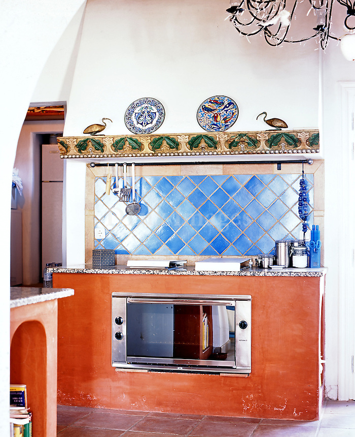 traditional kitchen with blue wall tiles
