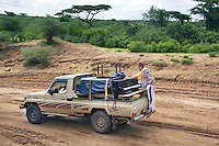 "Ethiopia. Southern Nations, Nationalities, and Peoples' Region. Omo Valley. On the road to Korcho Village and the Kara tribe. Robert Wolken stands on the bumper of a Toyota pick-up truck. He is a professional piano tuner and takes care of Marc Vella's Yamaha Grand Piano. Marc Vella is a french musician and a nomadic pianist. Over the last 25 years he has travelled with his piano in around forty countries to celebrate humanity. Creator of ""La Caravane amoureuse"" (The Caravan of Love) he takes people with him to say ""I love you"" to others and ""lovingly conquered"" their hearts and souls. The Omo Valley, situated in Africa's Great Rift Valley, is home to an estimated 200,000 indigenous peoples who have lived there for millennia. Amongst them are 1,000 to 2,000 Karo who dwell on the eastern banks of the Omo river. Southern Nations, Nationalities, and Peoples' Region (often abbreviated as SNNPR) is one of the nine ethnic divisions of Ethiopia. 8.11.15 © 2015 Didier Ruef"