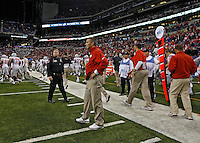 Ohio State Buckeyes head coach Urban Meyer takes a second before meeting Michigan State Spartans head coach Mark Dantonio after losing to Michigan State Spartans in the Big 10 Championship game at Lucas Oil Stadium in Indianapolis, Ind on December 7, 2013.  (Dispatch photo by Kyle Robertson)