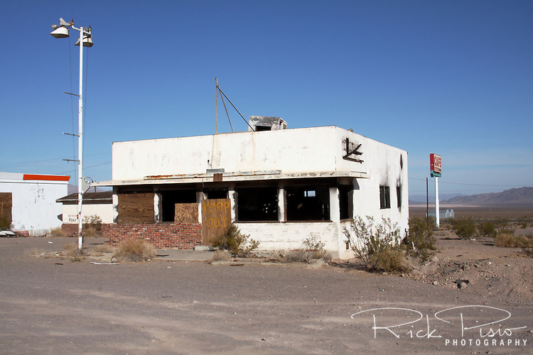 Abandoned and burned cafe along Route 66 in Ludlow, California. Prior to the construction of Interstate 40 Route 66 was the primary road through the Mojave Desert.