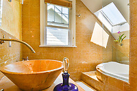 This bath in a 1920's home had been beautifully renovated. The right lenses and lighting--and the right angles can help make buyers and renters want your home.