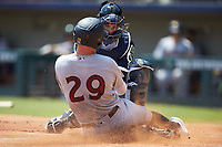 Trey Amburgey (29) of the Scranton/Wilkes-Barre RailRiders is tagged out at home plate by Gwinnett Stripers catcher John Ryan Murphy (12) at Coolray Field on August 18, 2019 in Lawrenceville, Georgia. The RailRiders defeated the Stripers 9-3. (Brian Westerholt/Four Seam Images)