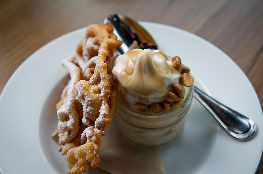 A desert dish of Georgia peanuts and coke soft serve with a waffle pastry on the side at Empire State South, photographed for Choice Tables on Saturday, April 23, 2011 in Atlanta.  (Rich Addicks/Photographer) 10110950A