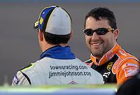 Apr 19, 2007; Avondale, AZ, USA; Nascar Nextel Cup Series driver Tony Stewart (20) talks with Jimmie Johnson (48) during qualifying for the Subway Fresh Fit 500 at Phoenix International Raceway. Mandatory Credit: Mark J. Rebilas