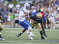 Annapolis, MD - October 7, 2017: Air Force Falcons quarterback Arion Worthman (2) spins out of a tackle during the game between Air Force and Navy at  Navy-Marine Corps Memorial Stadium in Annapolis, MD.   (Photo by Elliott Brown/Media Images International)