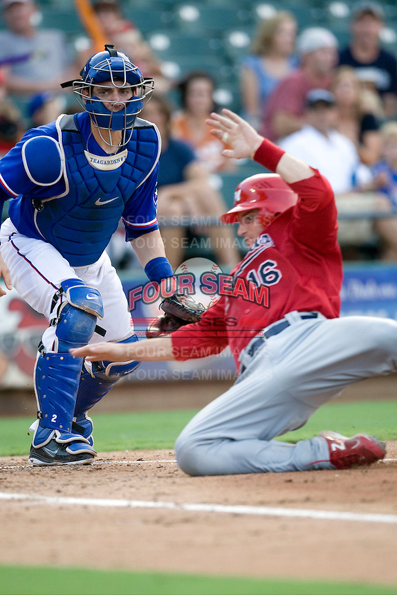 Round Rock Express catcher Taylor Teagarden #2 watches Memphis RedBirds baserunner Bryan Anderson #16 score at the Dell Diamond on July 10, 2011in Round Rock, Texas.  Memphis defeated Round Rock 10-9.  (Andrew Woolley / Four Seam Images)