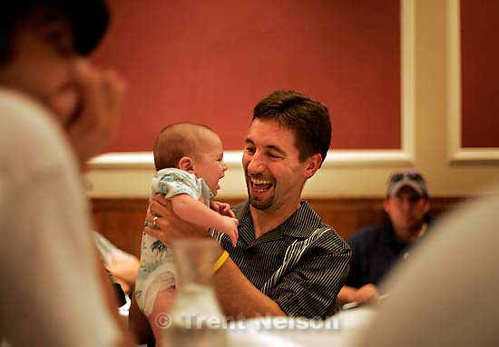 chuck wing with Laura Seitz's baby Dylan. Utah News Photographers' Awards Dinner. UNPA. at Lamb's Cafe<br />