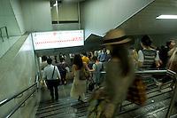 Landscape view of underground subway commuters walking in Shinjuku Eki following the 311 Tohoku Tsunami in Tokyo, Japan  © LAN