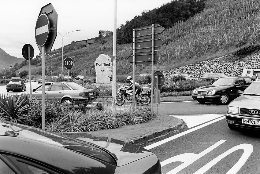 Italy. South Tyrol. Dorf Tirol. Traffic. cars and motorbike. Road symbol signs: Stop and No entry for vehicular traffic. South Tyrol (German: Südtirol; Italian: Sudtirolo, also known by its alternative Italian name Alto Adige) is an autonomous province in northern Italy. 14.08.1999 © 1999 Didier Ruef