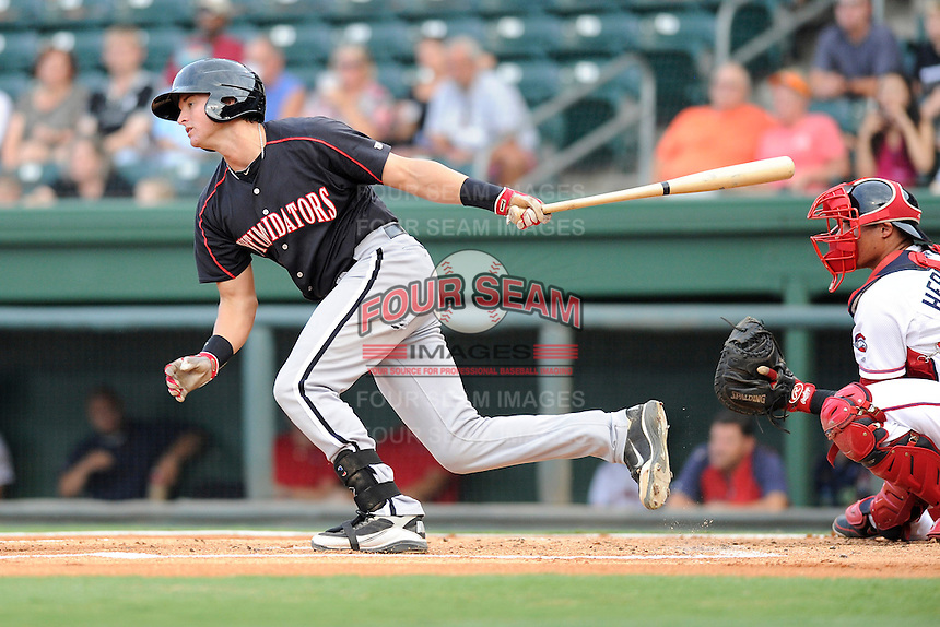 Catcher Mike Marjama (12) of the Kannapolis Intimidators in a game against the Greenville Drive on Monday, August 5, 2013, at Fluor Field at the West End in Greenville, South Carolina. The Drive catcher is Jayson Hernandez. Kannapolis won, 3-0. (Tom Priddy/Four Seam Images)