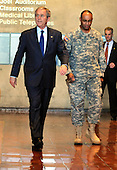 Washington, DC - December 22, 2008 -- United States President George W. Bush, left, walks in front of United States Army Colonel Norvell V. Coots, commander of Walter Reed Army Medical center, in Washington, Monday, December 22, 2008.  Bush praised the troops and those who care for them after visiting with the wounded and their families and said it would probably be his last visit there as commander-in-chief..Credit: Mike Theiler - Pool via CNP