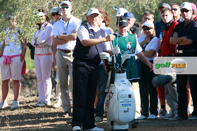 Colin Montgomerie (SCO) in the trees on the 13th hole during Thursday's Round 1 of the Castello Masters at the Club de Campo del Mediterraneo, Castellon, Spain, 20th October 2011 (Photo Eoin Clarke/www.golffile.ie)