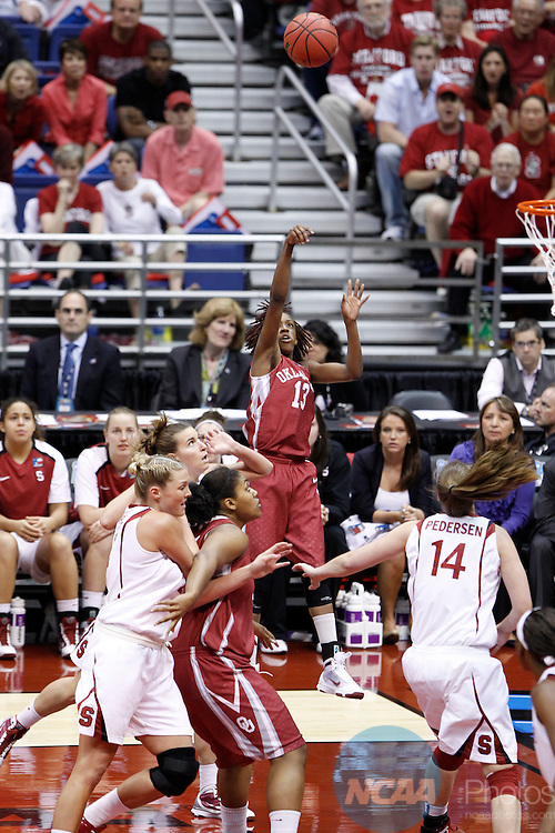 04 APR 2010:  University of Oklahoma guard Danielle Robinson (13) takes a jump shop during the Division I Women's Basketball Semifinals held at the Alamodome during the 2010 Women's Final Four in San Antonio, TX.  Oklahoma was defeated by Stanford University 73-66.  Trevor Brown, Jr./NCAA Photos