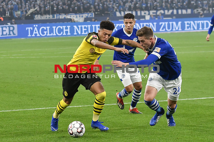 08.12.2018, Veltins-Arena, Gelsenkirchen, GER, 1. FBL, FC Schalke 04 vs. Borussia Dortmund, DFL regulations prohibit any use of photographs as image sequences and/or quasi-video<br /> <br /> im Bild v. li. im Zweikampf Jadon Sancho (#7, Borussia Dortmund) Bastian Oczipka (#24, FC Schalke 04) und Amine Harit (#25, FC Schalke 04) (mi.)<br /> <br /> Foto &copy; nordphoto/Mauelshagen