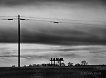 Mailboxes and phone lines line a quiet country road. Black and white art print