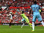 Zlatan Ibrahimovic of Manchester United shoots past the advancing Claudio Bravo of Manchester City to score their first goal during the Premier League match at Old Trafford Stadium, Manchester. Picture date: September 10th, 2016. Pic Simon Bellis/Sportimage