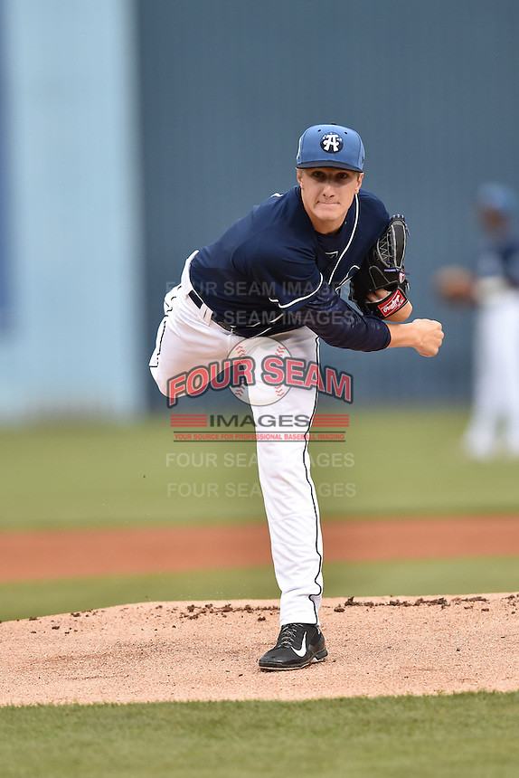 Asheville Tourists starting pitcher Ryan Castellani (6) warms up before game one of a double header against the Greenville Drive on April 18, 2015 in Asheville, North Carolina. The Tourists defeated the Drive 2-1. (Tony Farlow/Four Seam Images)