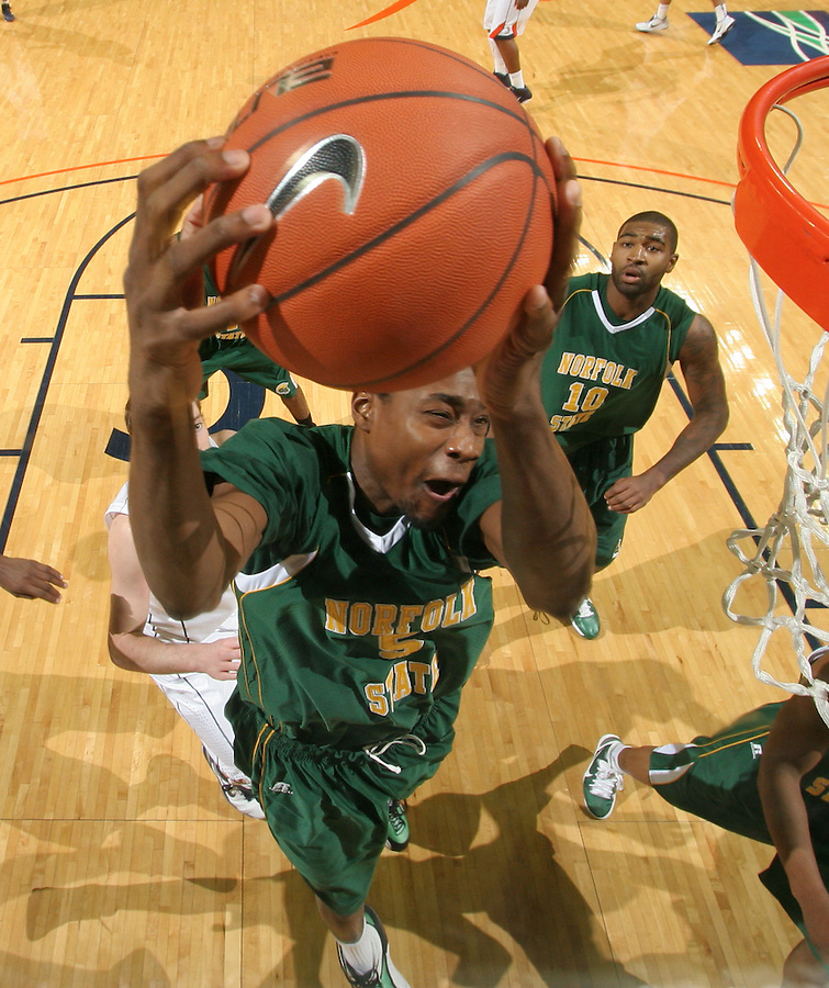 Dec. 20, 2010; Charlottesville, VA, USA; Norfolk State Spartans forward Tim Zephyr (5) grabs a rebound in front of Norfolk State Spartans forward Kyle O'Quinn (10) and Virginia Cavaliers guard Sammy Zeglinski (13) during the game at the John Paul Jones Arena. Virginia won 50-49. Mandatory Credit: Andrew Shurtleff