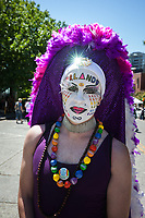 Gay man showing his support for Orlando shooting victims, PrideFest Parade, Seattle, WA, USA.