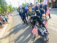 From left, Lana Leggett pushes Valerie Leggett 2, in a stroller as Joel Leggett, 4, walks alongside during the Hatfield Memorial Day Parade Monday May 25, 2015 in Hatfield, Pennsylvania. (Photo by William Thomas Cain/Cain Images)