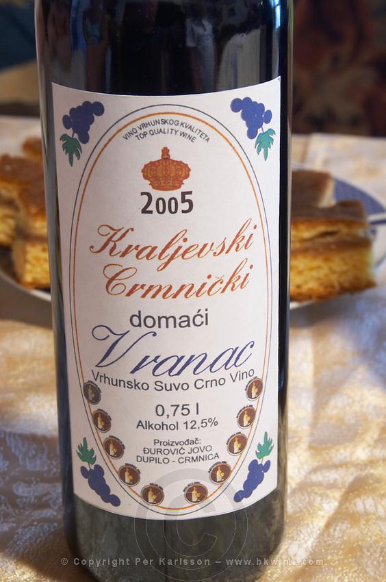 Bottle of Kraljevski Crmnicki domaci Vranac Vrhunsko Suvo Crno Vino 2005, red wine from the Vranac grape variety. Durovic Jovo Winery, Dupilo village, wine region south of Podgorica. Vukovici Durovic Jovo Winery near Dupilo. Montenegro, Balkan, Europe.