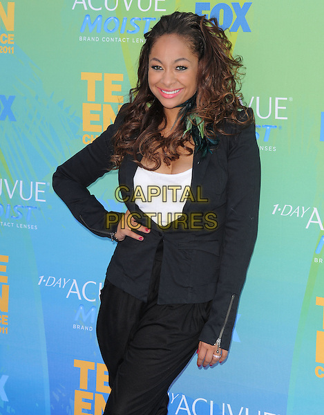 Raven Symone.The Fox 2011 Teen Choice Awards held at Gibson Ampitheatre in Universal City, California, USA..August 7th, 2010                    .half length hand on hip white top black jacket.CAP/RKE/DVS.©DVS/RockinExposures/Capital Pictures.