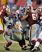 Landover, MD - November 30, 2008 -- New York Giants linebacker Antonio Pierce (58) and safety Michael Johnson (20) are blocked by Washington Redskins running back Clinton Portis (26), center Casey Rabach (61) and offensive guard Randy Thomas (77) as they attempt to blitz in late fourth quarter action against the Washington Redskins at FedEx Field in Landover, Maryland on Sunday, November 30, 2008.  The Giants won the game 23 -7..Credit: Ron Sachs / CNP.(RESTRICTION: No New York Metro or other Newspapers within a 75 mile radius of New York City)