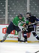 Notre Dame Fighting Irish of Batavia defensemen Bryan Moscicki (22) checks Matt Roe (9) during a varsity ice hockey game against the Brockport Blue Devils during the Section V Rivalry portion of the Frozen Frontier outdoor hockey event at Frontier Field on December 22, 2013 in Rochester, New York.  (Copyright Mike Janes Photography)
