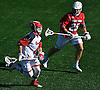 Corey Haynes #6 of St. John's University, left, carries downfield under pressure from Tyler Anderson #25 of Stony Brook during an NCAA Division I men's lacrosse game at DaSilva Memorial Field in Jamaica, NY on Sunday, Feb. 19, 2017. Stony Brook won by a score of 14-5.
